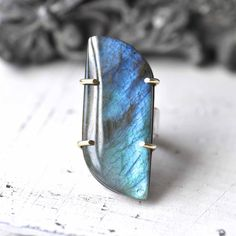 A one of a kind labradorite ring captures the blue of butterflies' wings and October skies. $169.00, via Etsy.