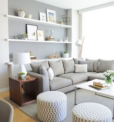 Living room- Beige instead of grey, cool sofa, glass table, box shelves, pictures.