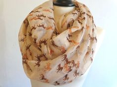 Khaki mini horses infinity scarf. You will love this lightweight infinity scarf.    Great addition to your wardrobe. You can wear this infinity scarf
