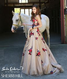 Long tan color prom dress with red/blue flowers and green leaves all over