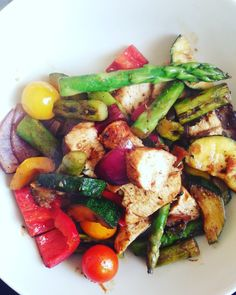 Asparagus salad with tomatoes, chicken, onions, peppers and zucchini