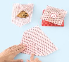 Wrapping cookies in colorful wax paper and then sealing it with a sticker.