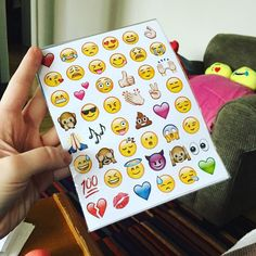 I ordered these emoji stickers so long ago and they finally came but now the OS has updated and all the emojis look different!  [photo of a hand holding up a pack of emoji stickers]