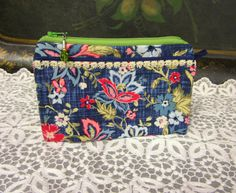 Cotton zipper pouch with vintage trims and beaded zipper pull.
