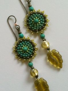 Teal Olive Yellow Circle Earrings by Jeka Lambert.  Seed bead woven.  Murano glass beads, chalk turquoise, pressed glass beads, seed beads.
