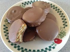 "Chocolate dipped ritz peanut butter crackers!!!  Simple spread peanut butter on a ritz. Top with another ritz. Dip the ""sandwich"" in melted chocolate. Enjoy!!"