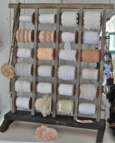 I love beautiful storage... look at this Lace/Ribbon Rack -- Just love the old spools for trims that are shorter in length... could be a pricey endeavor.