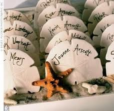 Sand dollar wedding favors, cute beach wedding idea  Combine with dinner seating two for one.