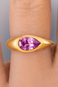 This regal sapphire comes from my favorite precision master gem cutter. Containing just a hint of purple, it's natural hue adds an element of cultured sophistication compared to a playful bubble gum pink. I loved the idea of creating a band of substantial 22k recycled gold that flowed around the gem like a modern river, following the elongated proportions of the pear-shaped sapphire. Budget Friendly Engagement Rings, Traditional Engagement Rings, Pink Sapphire Ring, Bubblegum Pink, Bubble Gum, Pear Shaped, Hue, Heart Ring, Gold Rings