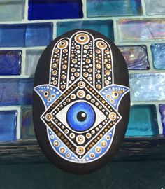 Hamsa hand painted stone. The Hamsa Hand is an ancient Middle Eastern amulet symbolizing the Hand of God. In all faiths it is a protective sign. It brings the owner…