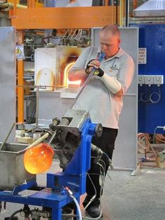 A master glass blower forms a vase at the Waterford Crystal company located in Waterford, Ireland.