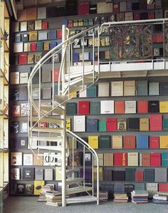 Full height bookcases + a spiral staircase to a mezzanine = pure lush!
