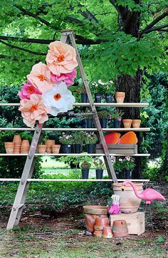Kristin Jackson repurposed an old step ladder to be a shelf for garden pots (and garden party favors). A Home Depot pink flamingo made an appearance, too, at her little girl's fourth birthday party. See more on The Hunted Interior.