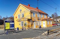 Drangedal, Norway, March 21, 2015: Traditional Norwegian wooden building railway station in small city Drangedal. Early spring.