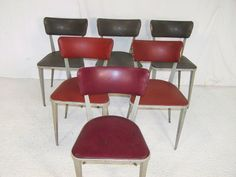 mixed set of Ernest race original alloy and leather dining chairs