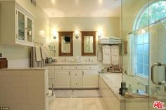 This beautiful, marble-finished bathroom is one of two-and-a-half in the home...