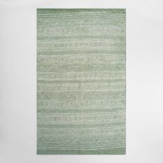Bleached instead of dyed to create its unique, reverse print-like pattern, our exclusive low-profile rug is hand woven of textured jute and soft cotton.