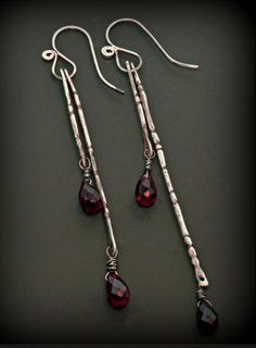 Sterling silver, garnet briolettes; hand fabricated, filed, drilled, liver of sulfur patina, hand finished  Sophia Georgiopoulou