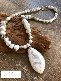 This beautiful Howlite necklace feature a white Howlite pendant which is the focal point for this stunning Statement Necklace Howlite is a white with grey veining stone. It is use to relieve stress of all kind This chunky necklace is made with Howlite pebbles, 8 mm Howlite round