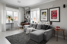 Living Room, Grey Accent Wall Also L Shaped Grey Sofa Plus Wooden Study Desk Besides Triangle Wooden End Table And Grey Shag Area Rug With White Sliding Curtain  Two Photo Frames  White Bay Window  Laminated Wood Flooring: 8 Best Living Room Color Pattern Ideas