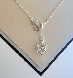 Silver Nautical Lariat Necklace with Anchor and Steering Wheel Pendants. $16.00, via Etsy.