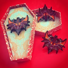 was it a bat? Or was it the face of the devil? -soft enamel pin -edition of 100 only cm wing span, black rubber clutch -presented in a handmade coffin shaped gift box in a choice of red blood droplets or cool powder blue Unusual Gifts, Black Rubber, Coffin, Psychedelic, Brooches, Devil, Blood, Powder, Wings