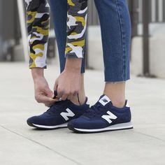 New Balance 420 navy sneakers.