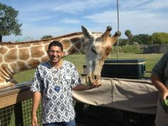 Here's a cool picture of Aakash Patel feeding #giraffes today at #buschgardens in #tampabay