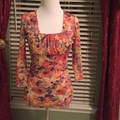 Floral Blouse Floral blouse,w/square neckline & gathered around breast area.Excellent condition.100% nylon.Size small.Smoke free home.❌❌NO TRADES❌❌ Tops Blouses