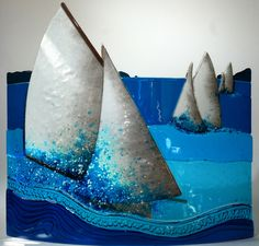Glass wave sculptures Studio glass boats Kiln formed glass sea creatures fish jellyfish Glass plates with a marine theme Glass Boat, Kiln Formed Glass, Glass Wall Art, Sea Creatures, Fused Glass, Nautical, Sculptures, Waves, Ceramics