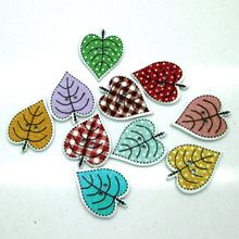 50Pcs/Set Free Shipping Multicolor Maple Buttons 2 Holes leaf shaped Buttons Scrapbooking Wood Sewing Accessories Knopf(China)