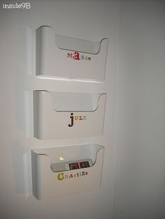 Ikea Pluggis boxes as mailboxes - one of the big boxes for each family member in our entryway