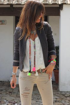 love the pops of neon, looks like she tied up cheap friendship bracelets to make that long necklace!