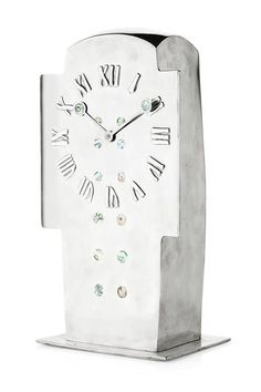 * ARCHIBALD KNOX (1864-1933) FOR LIBERTY & CO., LONDON 'TUDRIC' PEWTER AND ABALONE INLAID CLOCK, CIRCA 1902