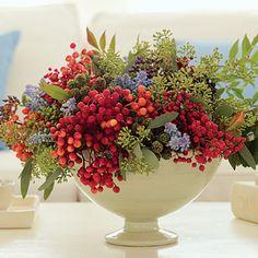 Blackberry cuttings, grape hyacinth (Muscari), nandina berries and leaves, red viburnum, and seeded eucalyptus.