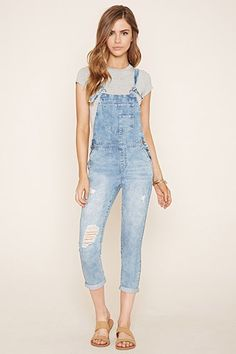 Distressed Denim Overalls pair of denim woven overalls with distressing on the legs, a four-pocket construction, buttons on each side, a bib patch pocket, and self-tie adjustable straps. Jumpsuit Denim, Womens Denim Overalls, Overalls Outfit, Dungarees, Teen Fashion, Fashion Outfits, Womens Fashion, Fashion Ideas, Outfits For Teens