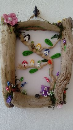 Family tree, in a driftwood frame with mini fairy houses by jaqnsfabfairies over on facebook x