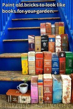 Bakstenen beschildetd als boeken,  voor de tuin