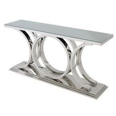 Communicate your individuality via polished stainless steel and thick, tempered glass. The Zaragoza 71 Console Table expresses the intention for singular decor through a circular ring base design. This piece bridges femininity and contemporary design. Welded Furniture, Console Furniture, Accent Furniture, Furniture Design, Metal Table Legs, Dining Table Legs, Balustrade Inox, Entrance Decor, Contemporary Interior Design