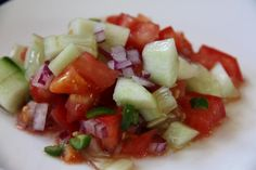 Thanks for this my darling daughter, Kelly Rose!    Ethiopian Tomato & Cucumber Salad from Food.com:   								From Homemakers magazine  Serve with Ethiopian Sauteed Lamb or Beef ( Ethiopian Sauteed Lamb or Beef )