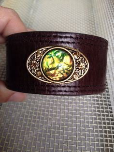 Holland's Trinkets    Up cycled belt made into cuff paired with a green pendant. Green Pendants, Class Ring, Cuffs, Pairs, Belt, Rings, Accessories, Jewelry, Fashion