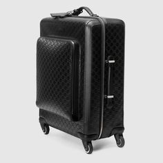 Shop the Gucci Signature carry-on by Gucci. A compact four wheel carry-on made in heat debossed Gucci Signature leather with a defined print and firm texture. Mens Travel Bag, Travel Bags, Mens Luggage, Fashion Terms, Gucci Store, Guccio Gucci, Gucci Gifts, Briefcase For Men, Carry On