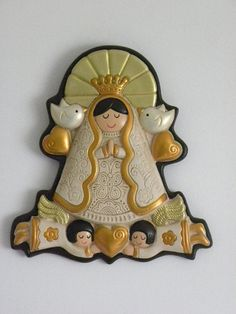 "One of a Kind Wall Deco Ceramic ""Virgencita Plis"" portrayed with Girl Face carried by two Angels and inspired by the whispers of two Doves ( The Holy Spirit).  Carefully hand painted with non-toxic paint and made of delicated ceramic;  a very unique Wall Hanging Deco Figure for children room, or for your favorite spot at home or business. Ideal for confirmation, Birthday, First Communion, Housewarming and Baptism Gift."