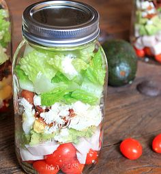 Cobb Salad In A Jar          1 pint cherry tomatoes          6 slices, turkey bacon- cooked.          8 ounces turkey deli meat or chicken breasts          1 to 2 avocado          crumbled blue cheese or feta          3 hard boiled eggs          romaine lettuce