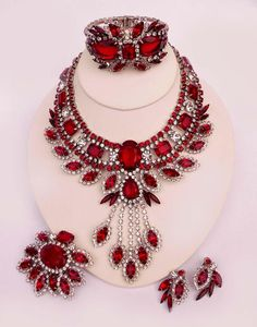 Ravishing Red - 2007  DiMartino Originals is the signature of a Tennessee artist who has been making jewelry for more than 20 years. She taught herself the almost-lost art of costume jewelry making; combining it with her copious artistic talent, she has created some of the most beautiful rhinestone jewelry. She uses primarily Swarovski Austrian crystal rhinestones, vintage and hand-painted cabochons, many of which are no longer being made.