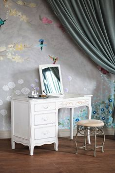 A dreamy vanity and hand-painted floral wallpaper that's perfect for spring.