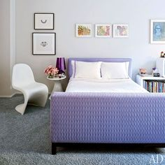 The custom-made bed in Tamsin's room is upholstered in a purple Donghia fabric; the Verner Panton side chair is by Vitra.