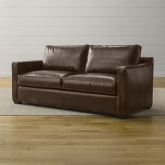 Shop Davis Comfortable Leather Sofa. Davis always appears ready for company, with slim track arms and self-welt tailoring on rich leather that gains a warm patina over time.