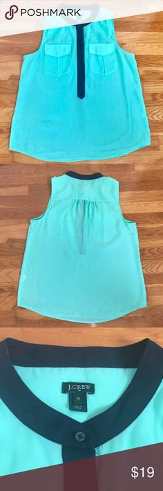 J. CREW FACTORY | Mint and Navy Sleeveless Blouse MINT!!! Sleeveless blouse with navy blue placket. This is a great piece that can be worn to work or Sunday brunch with white jeans. Size 10 J. Crew Factory Tops