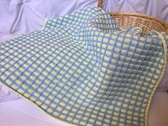 Baby blue and yellow tunisian crochet baby blanket. This is a very special handmade crochet baby blanket.  This baby afghan will make a wonderful baby shower gift.  This blanket would make a lovely addition to your baby nursery decor. Perfect also, for travel, strollers, prams, cribs, tummy time and photo props